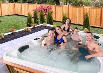 Friends drinking in the hot tub